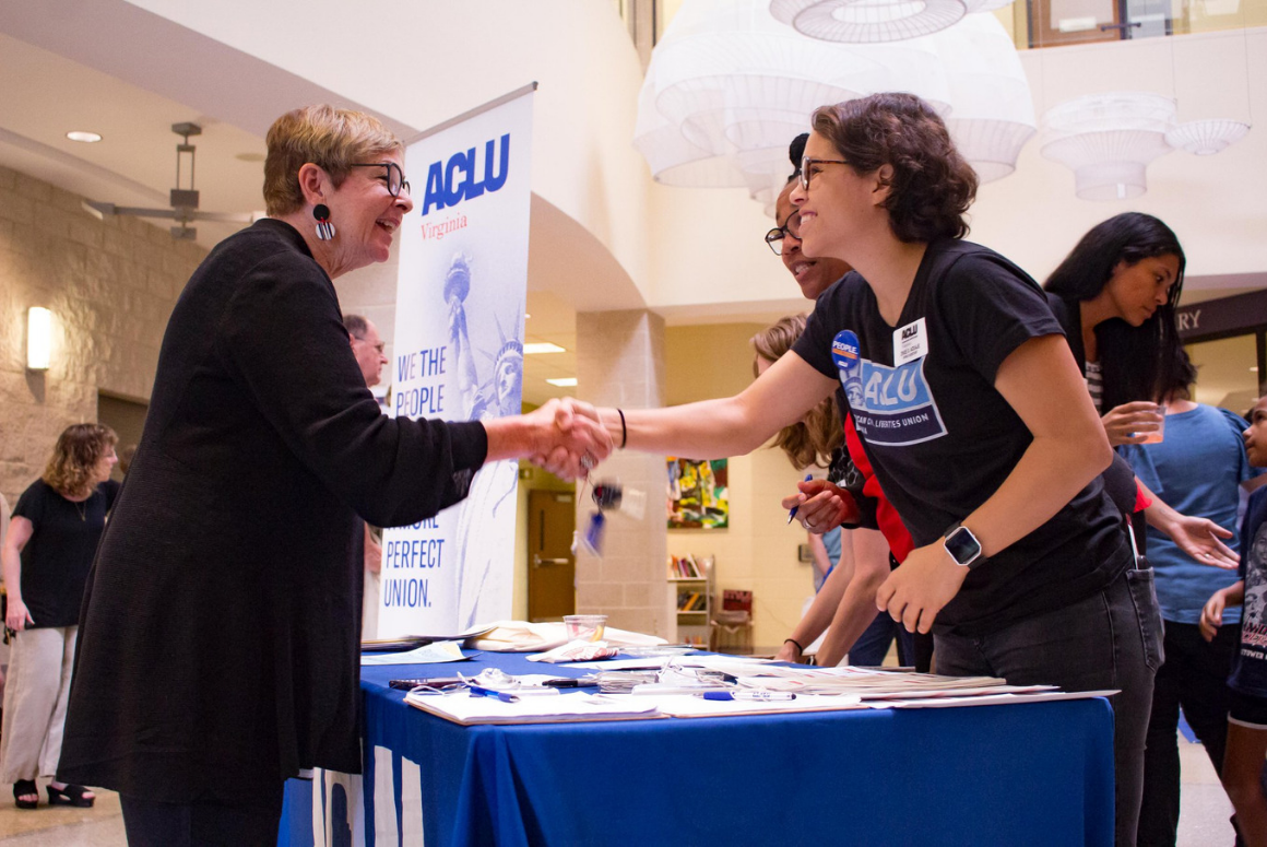 ACLUVA Office Assistant Zhue shook hand with guests at our annual meeting