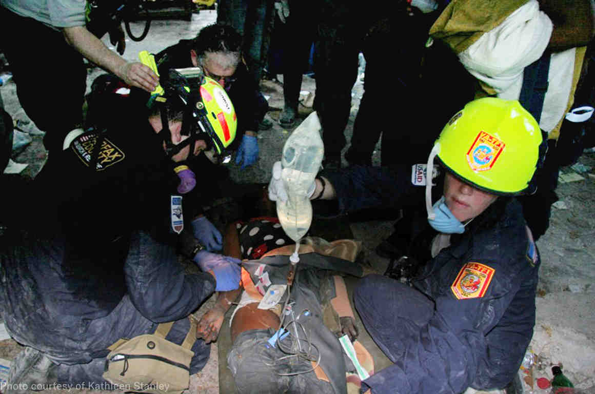 our client kathleen stanley in her firefighter uniform caring for an injured person