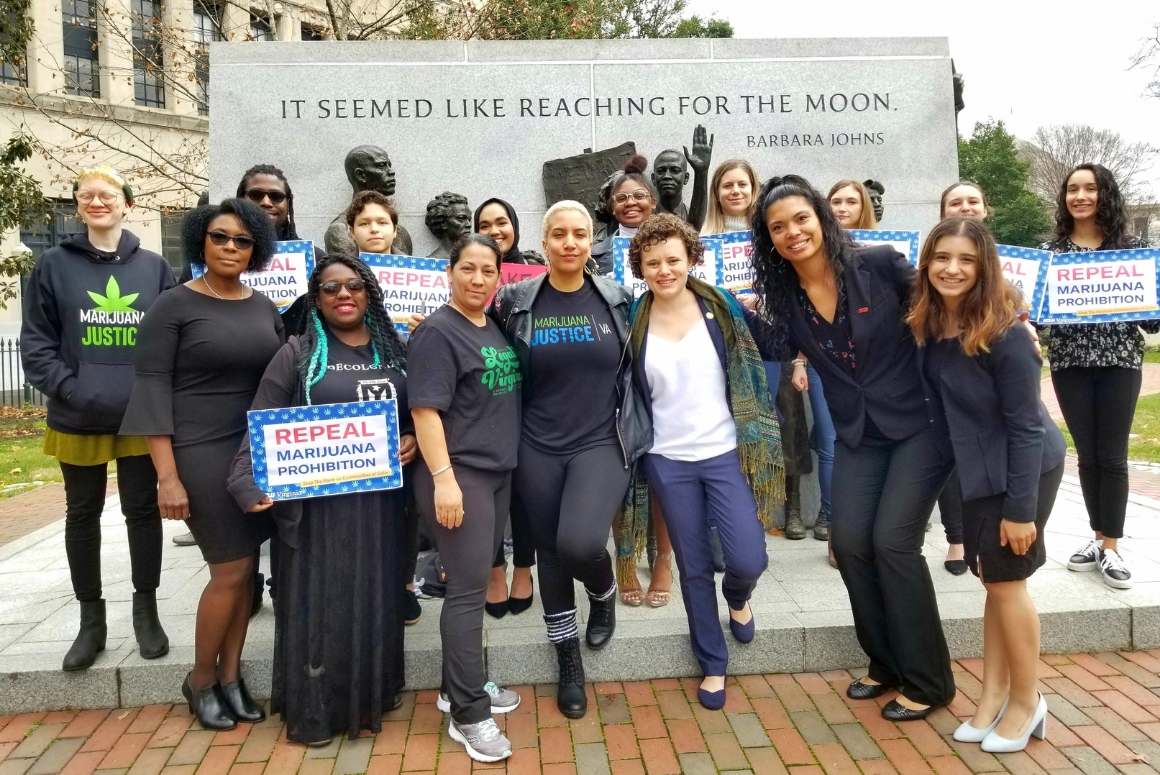 Group of advocates posing in front of Barbara Johns statue