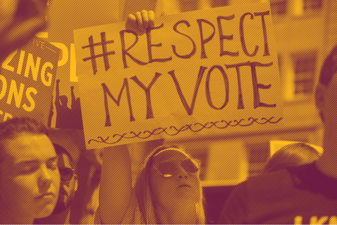 "A white woman holding a sign that says ""hashtag Respect My Vote"""