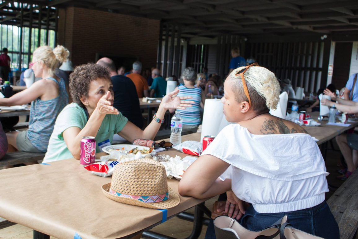 Two black women talking over food at the 2018 Northern Virginia Chapter's Annual Meeting and CrabFest