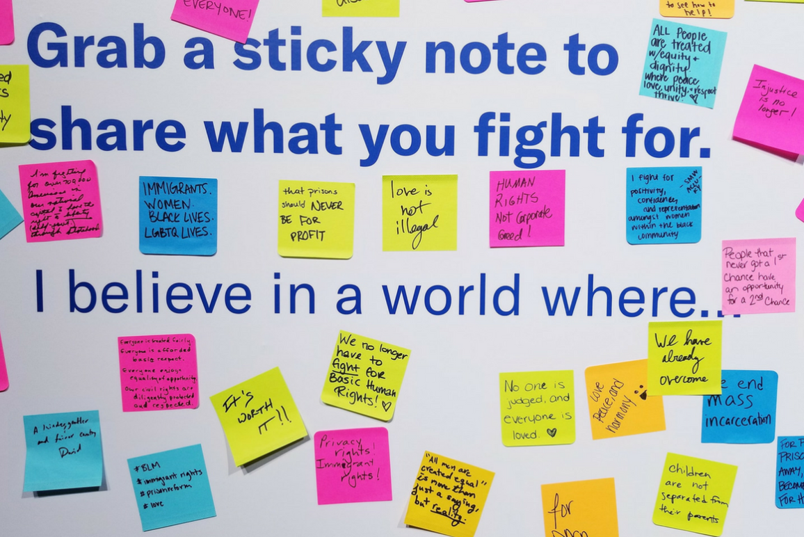 A picture of a wall full of sticky notes about what people fight for, from the ACLU Membership Conference