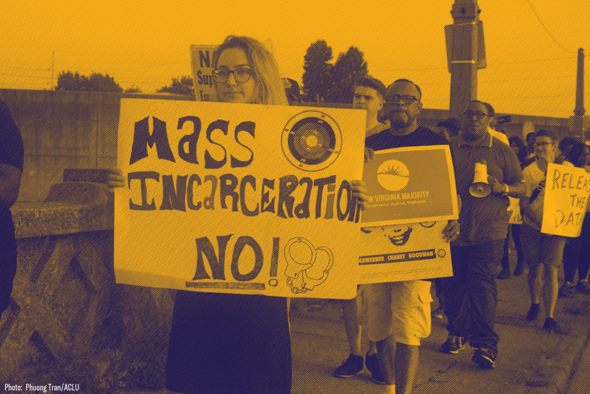 "A protester holding sign that says ""Mass incarceration No!"""