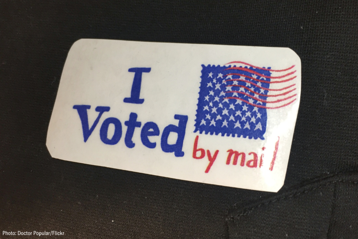 a sticker that says I voted by mail