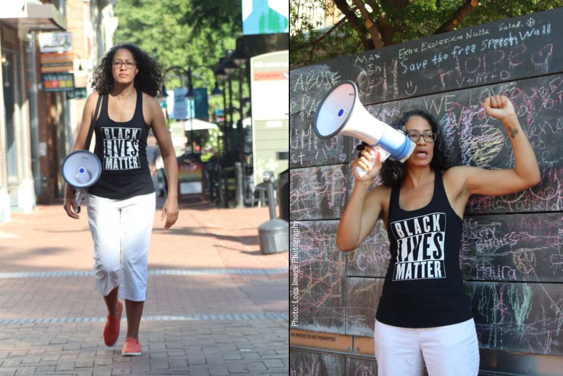picture of our client Jalane Schmidt, wearing a Black Lives Matter tank top and holding a megaphone