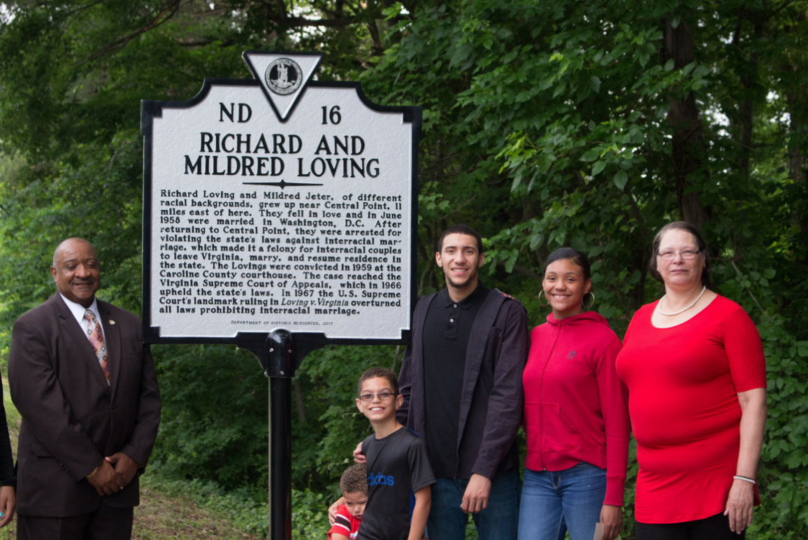 The Lovings' family standing in front of the historic marker dedicated to them.
