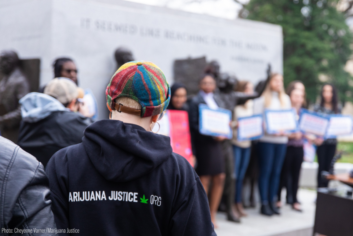 a protester wearing a hoodie with Marijuana Justice logo on