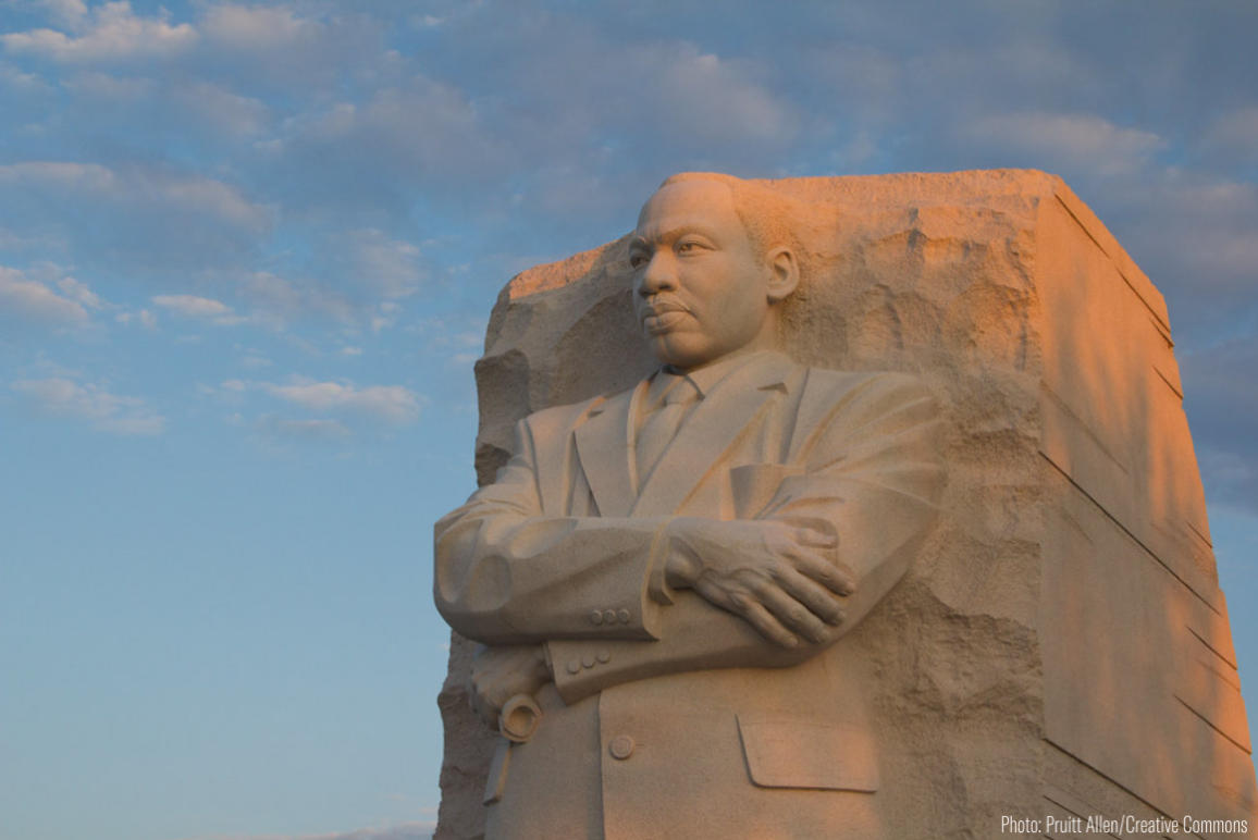 a statue of Dr. Martin Luther King Jr. in Washington DC at sunset