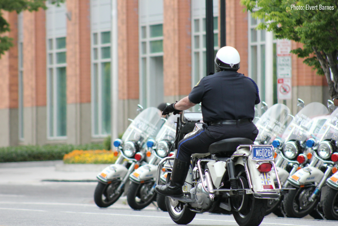 A police officer riding a motorcycle