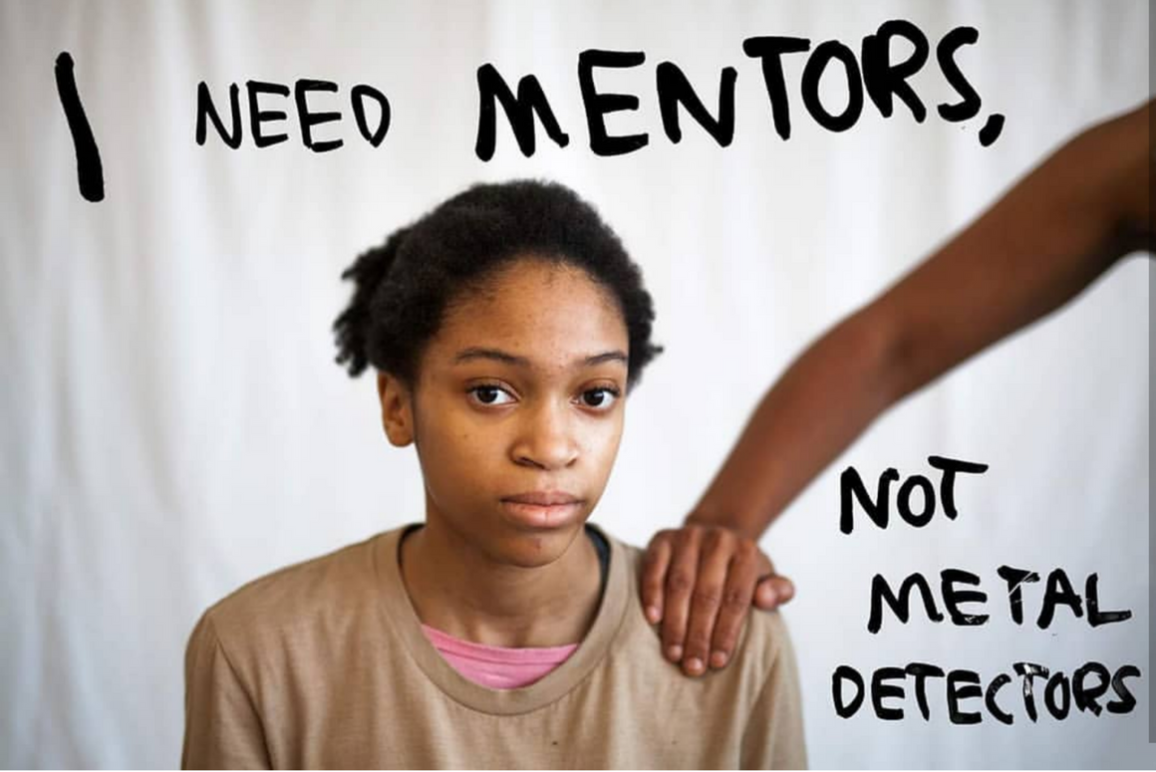 A profile picture of Stephanie Younger, with the word 'I need Mentors, not metal detector' on the white space