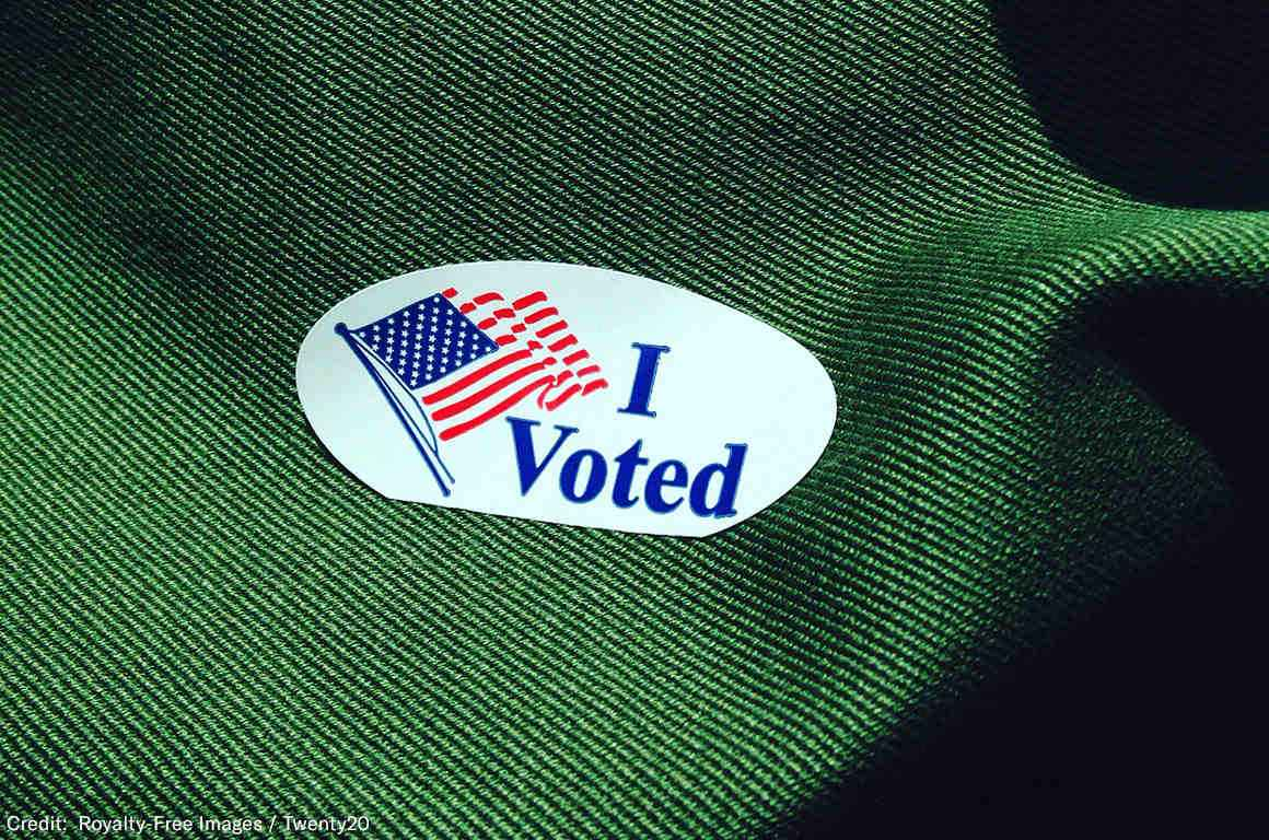 Voting sticker on green fabric