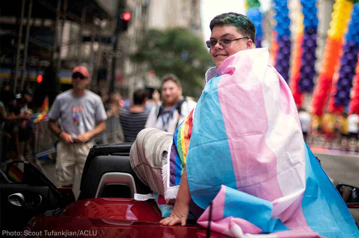 Gavin Grimm wearing the trans flag at NYC Pride