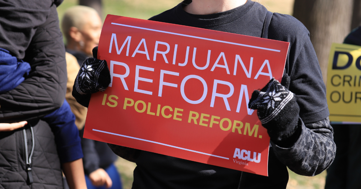 """a red protest sign that says """"marijuana reform is police reform"""""""