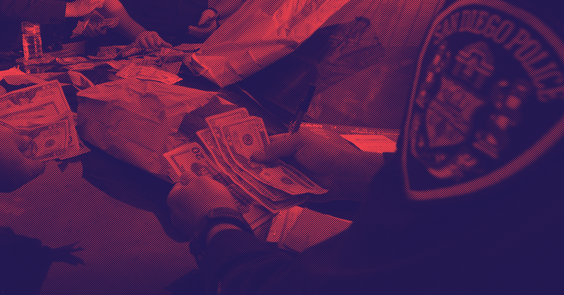 A picture of police officers counting cash they seized via civil asset forfeiture