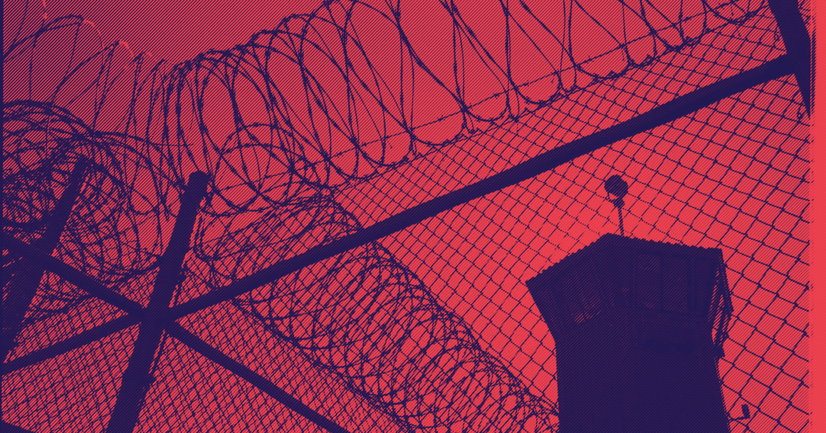 a picture of barbed wire and a prison watch tower